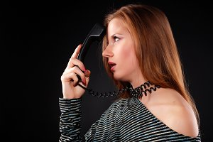 woman with black telephone