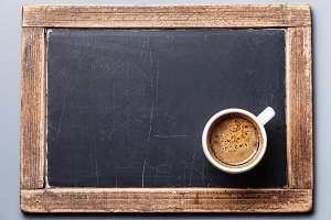 Coffee cup on chalk board