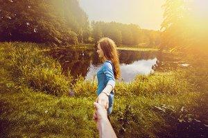 Girlfriend holding boyfriend hand.