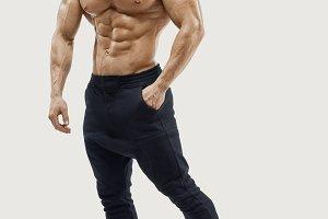 Shirtless male bodybuilder posing
