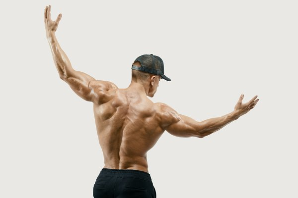 Muscular young man turning back