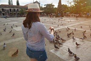 Girl feeding doves