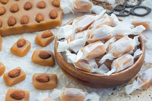 Homemade soft caramel candy with almonds, horizontal