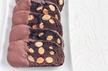 Homemade dark chocolate biscotti cookies with almonds, covered with melted chocolate, horizontal, copy space