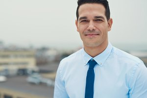 Handsome young Hispanic businessman
