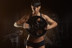 Workout with barbell plate