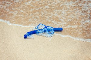 Snorkel mask on the beach