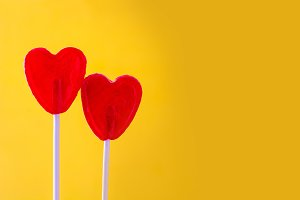 Red lollipop with heart shape