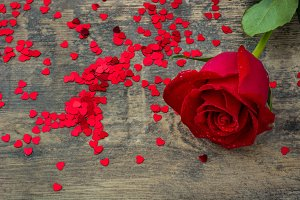 Red rose and confetti