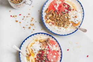 Healthy breakfast yogurt bowls with granola, fresh and dried fruits