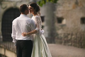 Groom hugs a brunette bride