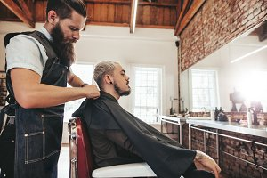 Barber covering client