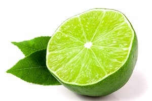 half a lime with leaves isolated on white background