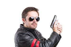 Man in black leather jacket with gun