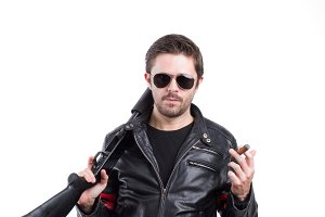 Man in leather jacket with shotgun
