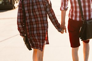 guy and girl in plaid shirt holding hands