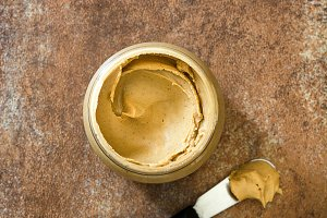 Creamy peanut butter and spoon