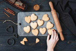 Female hand holding the cookie-heart
