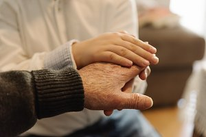 Holding hands of different age.