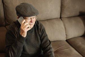 Senior man using his mobile phone.