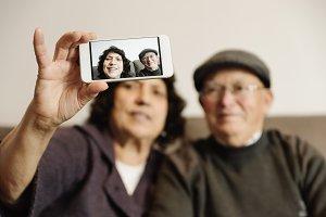 Senior rmarriage using his mobile.
