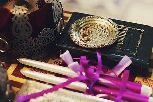 Wedding rings lie on a golden plate