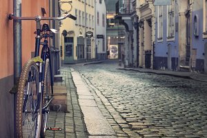 texture of stone and cobblestone, bicycle on a city street