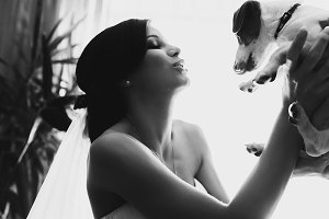 Bride playing with a dog