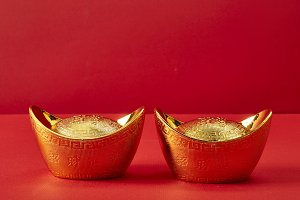 Gold ingots on a red background