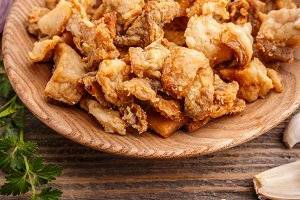 Plate of salty pork greaves