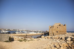 Paphos City, Cyprus - JULY 16, 2015: The harbour and Paphos medieval fort in the afternoon