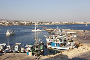 Paphos City, Cyprus - JULY 16, 2015: Boats docked in Paphos harbour in the afternoon