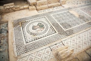 Kourion, Cyprus - JULY 18, 2015: Mosaic floor of building from ancient Roman city of Curium.