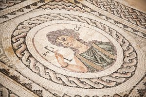 Kourion, Cyprus - JULY 18, 2015: Mosaic on the floor of building from ancient Roman city of Curium.