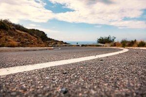 Crete Island, Greece: Low angle view of mountain road, shallow DOF