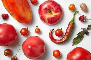 Red chili pepper and tomato .