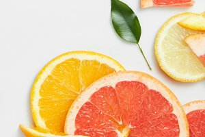 Close up of fresh citrus slices and leaf