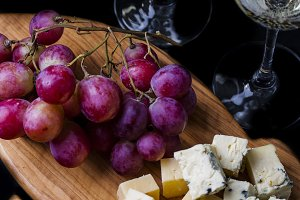 composition with grape, wine and cheese