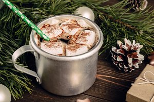 Hot chocolate with marshmallow and green straw