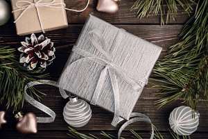 Silver gift with bow and Christmas decorations