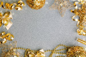 Golden Christmas decorations on glitter background