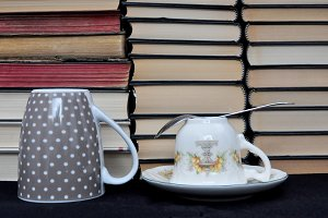 piled books and cups