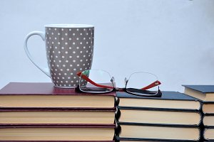 books, cup and glasses