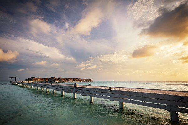 Wooden jetty and water villas. Mald…