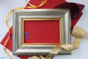 Decorated frame with red paper