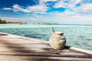 Wooden jetty towards a small island in Maldives