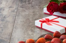Heart shaped cake,gift box and roses