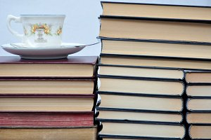 cup and piled books