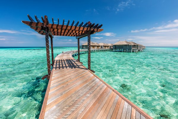 Wooden jetty towards water villas i…