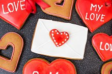 Heart cookies with letter on dark background